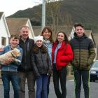 Writer Geraldine de Brit on her street in Sutton, Dublin, with husband Donnacha McCarrick and children (from left) Denis (13), Grace (11), Jacqueline (17) and Ronan (14). Photograph: Dave Meehan
