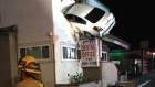 Dashcam captures airborne car crashing into building