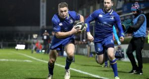 Leinster's Jordan Larmour scores a try against Ulster.  Photograph: Ryan Byrne/Inpho