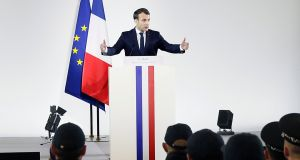 French president Emmanuel Macron delivers a speech to police officers and gendarmes in the Gendarmerie headquarters in Calais, northern France, on Tuesday. Photograph: Etienne Laurent/EPA