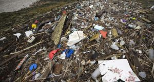 Plastics and other detritus line the shore of the Thames Estuary. Photograph:  Dan Kitwood/Getty Images