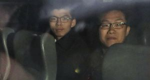 Pro-democracy activists Joshua Wong (left) and Raphael Wong being escorted in a prison van leaving the high court after sentencing in Hong Kong on Wednesday. Photograph: Kin Cheung/AP