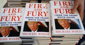 A shop worker arranges copies of Michael Wolff's book Fire And Fury as they go on sale inside a branch of the Waterstones book store in Liverpool on January 11th. Photograph: Phil Noble/Reuters
