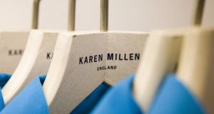 Clothes hang on the rack at a Karen Millen clothing store.  Photographer: Chris Ratcliffe/Bloomberg News