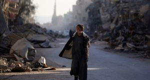 A man walks through a street in Syria's devastated city of Raqa. Photograph: Delil Souleiman/AFP/Getty Images