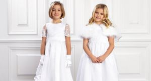 White communion dresses called Isobel and Pippla, €100 each by Paul Costelloe for Dunnes Stores. Boleros €30, cardigan €20, veil €25, shoes €30 and tights €5.