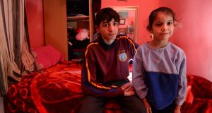 "Rado Rostas and his niece Liza at home in north inner city Dublin, where eight people share two beds and the heating does not work: ""Roma In Ireland: A National Needs Assessment"" examines the Roma experience in Ireland. Photograph: Dara Mac Dónaill"