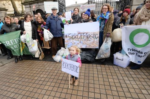 REDUCE, REUSE, RECYCLE Three-year-old Astrid Gundersen, from Swords, Co Dublin, with campaigners from  Zero Waste Ireland, Voice, Uplift and Friends of the Earth outside the Oireachtas, where they presented a petition for a deposit-and-return scheme for plastic bottles, one of the provisions in the Waste Reduction Bill. Photograph: Alan Betson