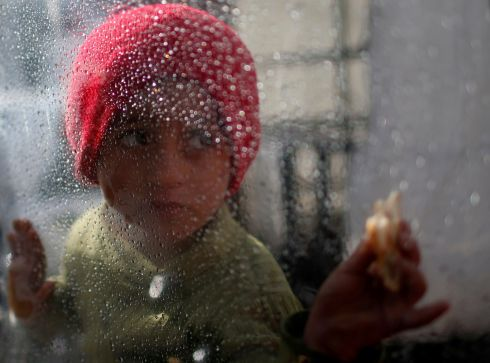 SHELTER A Palestinian refugee at the al-Shati camp, in Gaza city. Photograph: Mohammed Salem/Reuters
