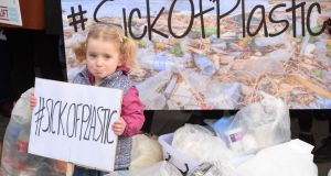 Astrid Gundersen  (3), from Swords, at the Friends of the Earth protest outside the Dáil on Wednesday as the joint Oireachtas environment committee began hearings on the Waste Reduction Bill. Photograph: Alan Betson