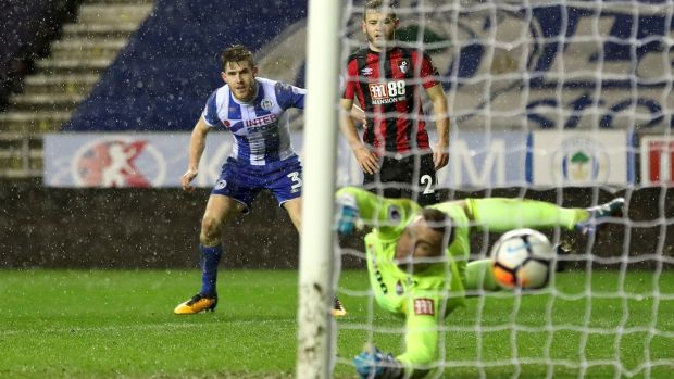 Wigan Athletic's Callum Elder (left) scores his side's third goal in the FA Cup third round replay against Bournemouth at the DW Stadium. Photograph: Martin Rickett/PA Wire