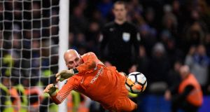 Chelsea goalkeeper  Willy Caballero  saves a penalty from Nelson Oliveira of Norwich City during the FA Cup third-round replay  at Stamford Bridge. Photograph: Mike Hewitt/Getty Images