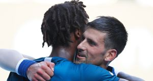 Novak Djokovic with Gael Monfils after his second round win in Melbourne. Photograph: Narendra Shresta/EPA