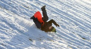 Cillian Cribbins tumbles down the slopes at the Hill of Tara during recent snow fall. Photograph: The Irish Times