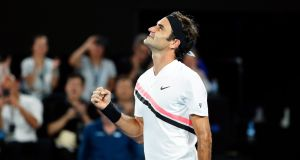 Dedending champion Roger Federer is through to the third round of the Australian Open. Photograph: Mast Irham/EPA