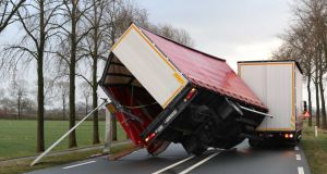 A lorry trailer is blown over by the strong winds of the western storm in Kampen, the Netherlands. Photograph: EPA/Ginopress BV