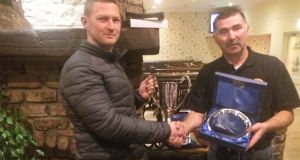 Ruairi Coleman (left), South Shore Master Angler 2017, receiving the MA Cup from club member Thomas Keogh