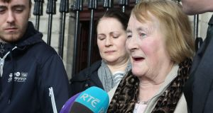 Esther Lonergan  speaks to reporters after her family settled cases against two hospitals following the deaths of her husband and son. Photograph: Collins