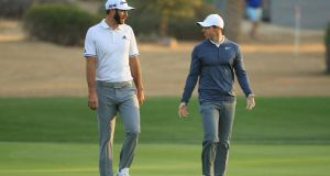 Dustin Johnson  and Rory McIlroy walk on the 10th hole during round one of the Abu Dhabi HSBC Golf Championship. Photograph: Andrew Redington/Getty Images