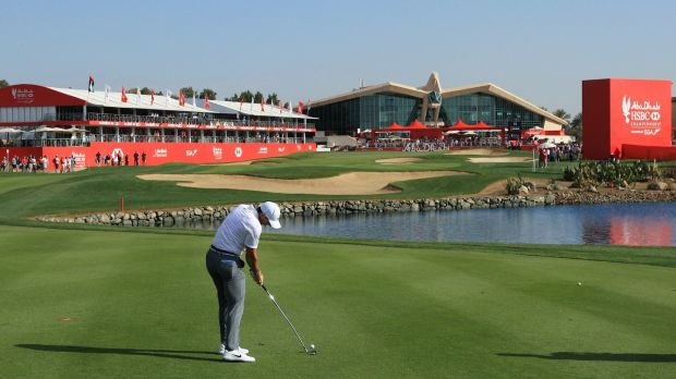 Rory McIlroy plays his second shot on the 18th hole during round one of the Abu Dhabi HSBC Golf Championship. Photograph: Andrew Redington/Getty Images