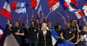 France's National Front party president Marine Le Pen sings the French national anthem. Photograph: Pascal Rossignol/Reuters