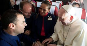 Pope Francis celebrates the marriage of crew members Paula Podest (C) and Carlos Ciufffardi (L) during the flight between Santiago and the northern city of Iquique, Chile. Photograph: Osservatore Romano/Reuters