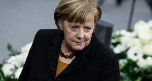 Acting German chancellor Angela Merkel arrives at a memorial ceremony for the deceased former president of the German parliament Philipp Jenninger in Berlin. Photograph: Clemens Bilan/EPA