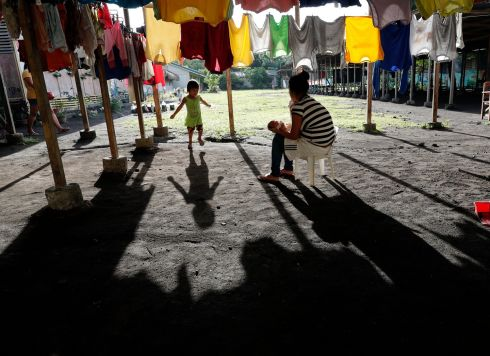 TAKING SHELTER: Filipino villagers take shelter at a school being used as a temporary evacuation centre in the vicinity of a rumbling Mayon Volcano in the town of Daraga, Albay province, the Philippines. Photograph: Francis R Malasig/EPA