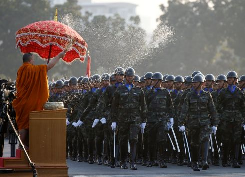 OATH OF ALLEGIANCE: Thai soldiers are sprinkled with holy water by a Buddhist monk as they parade at a ceremony to take an oath of allegiance on Royal Thai Armed Forces Day, at a military base in Bangkok, Thailand.  Photograph: Narong Sangnak/EPA
