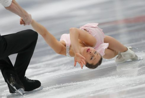 FIGURE SKATING: Lola Esbrat and Andrei Novoselov of France perform during the pairs short programme of the ISU European Figure Skating Championships in Moscow, Russia. Photograph: Sergei Ilnitsky/EPA