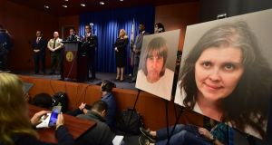 Riverside County District attorney Michael Hestrin speaks during a press conference in Riverside, California, about the charges brought against David and Louise Turpin (photographs displayed), who are accused of holding  their 13  children captive in horrific conditions. Photograph: Frederic J Brown/AFP/Getty Images