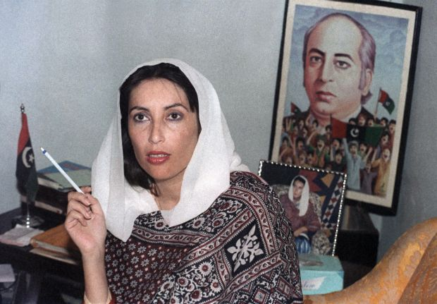 Pakistani People's Party leader Benazir Bhutto holds a press conference in front of a poster of her father (executed prime minister Zulfikar Ali Bhutto) at her home in Larkana as she won first parliamentary elections in 1988.