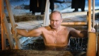 Putin strips off to take a dip in icy waters for Orthodox Epiphany