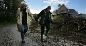 Steph and Tony Booth walking near the house they were renovating near Blacklion Co Cavan. Photograph: Frank Miller
