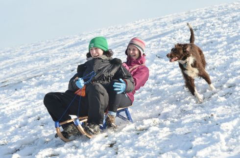 SNOW ON TARA: Evelyn Cribbons, from Dunshaughlin, with Jenny Copeland, from Drumree, Co Meath, on the slopes at the Hill of Tara, enjoying snowfall this week. Photograph: Alan Betson/The Irish Times