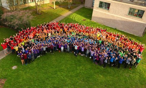 OVER THE RAINBOW: Students and teachers at King's Hospital, Dublin, create a rainbow at the end of the school's first ever LGBT+ week, with Senator David Norris raising a rainbow flag to bring the event to a close. Photograph: Darren Kinsella