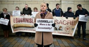 Emma Rogan, the daughter of Adrian Logan who was murdered by loyalist gunmen in the Heights Bar, Loughinisland protests outside Belfast High Court on January 19th, 2018. Photograph:  Charles McQuillan/Getty Images