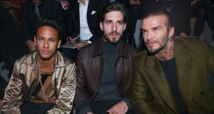 Neymar,  PSG goalkeeper Kevin Trapp and  David Beckham attend a fashion show in Paris on Thursday. Photograph:  EPA/STR