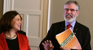 Sinn Féin leader Gerry Adams laughs as Mary Lou McDonald watches after a pre-election news conference in Dublin in  February 24, 2016. Photograph: Clodagh Kilcoyne/Reuters