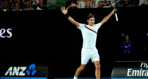 Roger Federer celebrates after winning his third round match against Richard Gasquet of France at the Australian Open in Melbourne, Australia. Photo: Tracy Nearmy/EPA