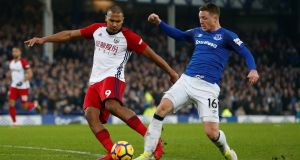 Everton's James McCarthy tackles West Bromwich Albion's Salomon Rondon, resulting in a suspected broken leg. Photo: Andrew Yates/Reuters