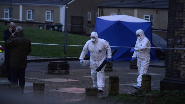 A Garda forensic unit at the scene at Bridgeview halting site near Cloverhill Road in west Dublin. Photograph: Cyril Byrne/The Irish Times