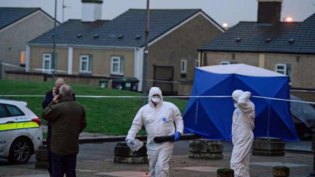 Forensic Garda at the scene of the shooting at Bridgeview halting site off Cloverhill Road on Saturday evening. Photograph: Cyril Byrne/The Irish Times