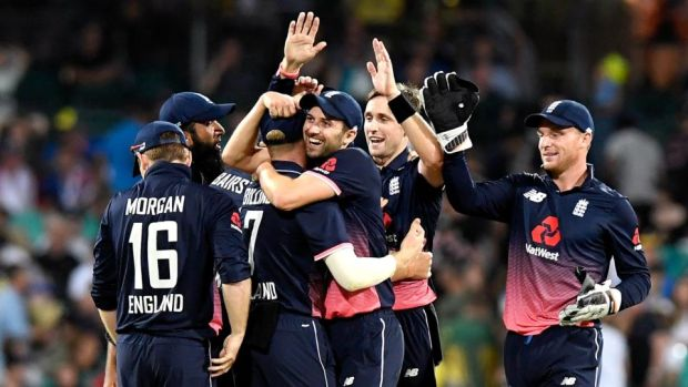 England celebrate the key wicket of Marcus Stoinis in Sydney. Photograph: Bradley Kanaris/Getty
