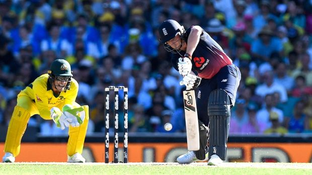 Jos Buttler plays a shot into the off side during his century in Sydney. Photograph: Bradley Kanaris/Getty