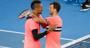 Nick Kyrgios of Australia and Grigor Dimitrov of Bulgaria embrace after their fourth round match at the Australian Open. Photo: Darrian Traynor/Getty Images