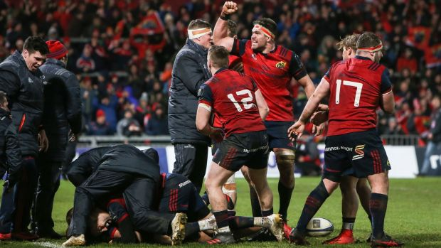Billy Holland and Munster celebrate Simon Zebo's second half score against Castres. Photograph: Gary Carr/Inpho