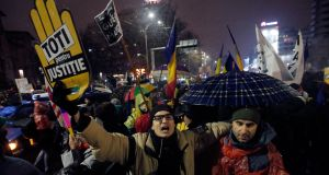 An estimated 50,000 people marched towards parliament from the iconic University Square in Bucharest to oppose changes to the judiciary system. Photograph:  EPA/Robert Ghement