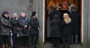SAYING GOODBYE: Eileen O'Riordan (front right), mother of late Cranberries singer Dolores O'Riordan, turns as her daughter's coffin arrives at St Joseph's Church in Limerick, Ireland, for a public reposal. Photograph: Niall Carson/PA Wire