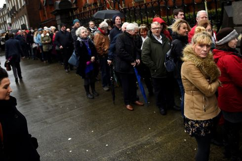 PUBLIC SEND-OFF: Members of the public queue to see the coffin of late Cranberries singer Dolores O'Riordan as it is carried into St Joseph's Church for a public reposal in Limerick. Photograph: Clodagh Kilcoyne/Reuters